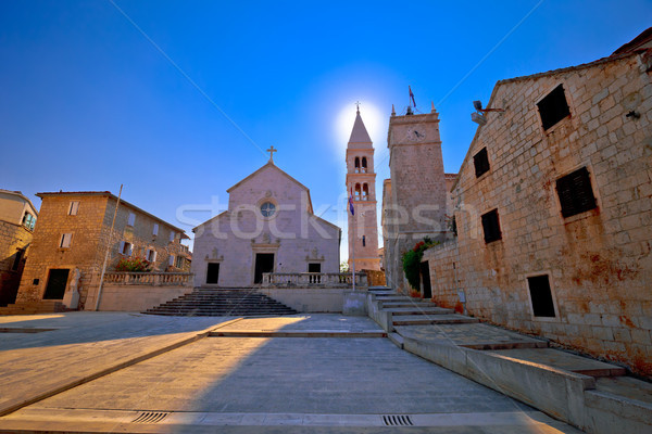 Square and church view in Supetar at sunset Stock photo © xbrchx