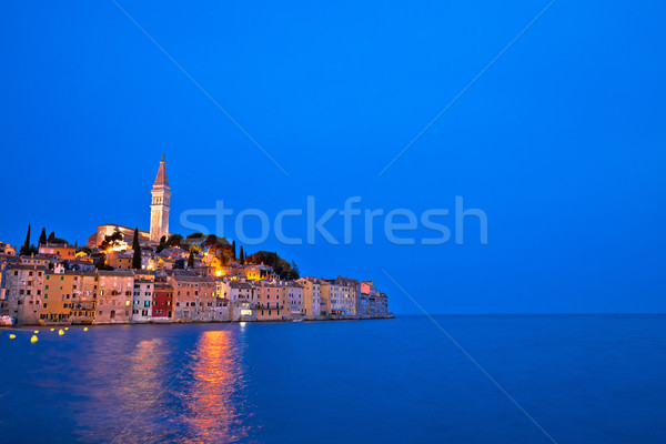 Stad avond exemplaar ruimte zonsondergang landschap Stockfoto © xbrchx