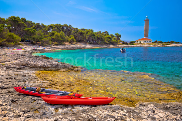 Veli Rat lighthouse and turquoise beach view Stock photo © xbrchx