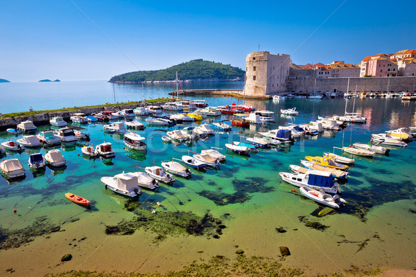 Dubrovnik harbor and city walls view Stock photo © xbrchx