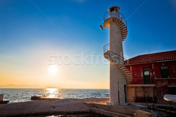 Phare coucher du soleil ciel bâtiment lumière mer Photo stock © xbrchx