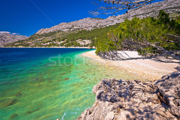 Idílico playa vista agua mar montana Foto stock © xbrchx