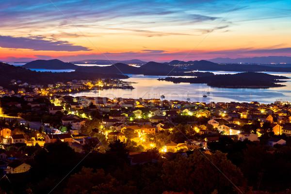 Szigetvilág naplemente sziget kilátás épület tenger Stock fotó © xbrchx