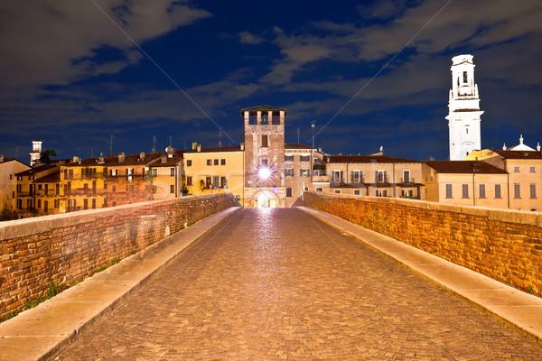 Ponte Pietra bridge and Verona waterfront architecture evening v Stock photo © xbrchx