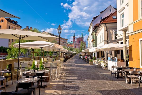Ljubljana riverfront promenade walkway summer view Stock photo © xbrchx