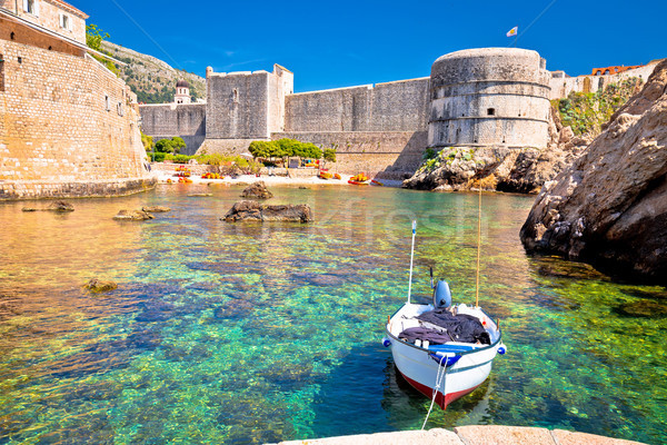 Small harbor under Dubrovnik city walls view Stock photo © xbrchx