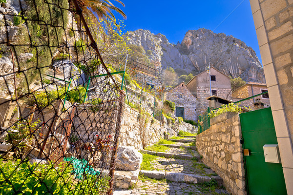 Omis old stone mediterranean street under rock view Stock photo © xbrchx