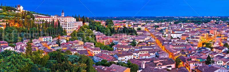Verona old city and Adige river panoramic aerial view at evening Stock photo © xbrchx