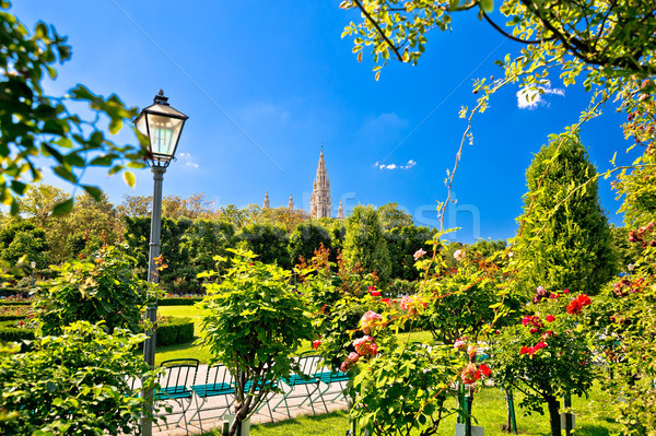 Green Volksgarten park of Vienna and city hall view Stock photo © xbrchx