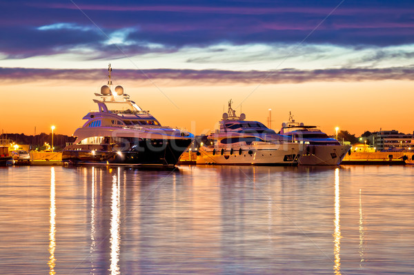 Luxury yachts harbor at golden hour view Stock photo © xbrchx