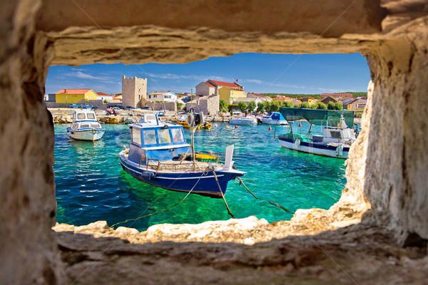 Turquoise bord de l'eau pierre fenêtre plage maison Photo stock © xbrchx