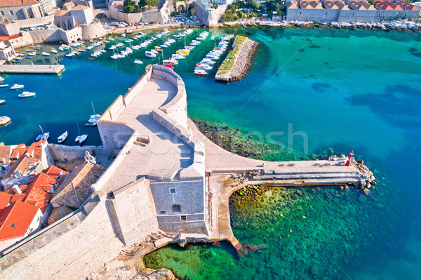 Dubrovnik harbor and strong defense walls aerial view Stock photo © xbrchx