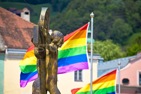 Jesus Christ crucifixion and gay pride flags view Stock photo © xbrchx