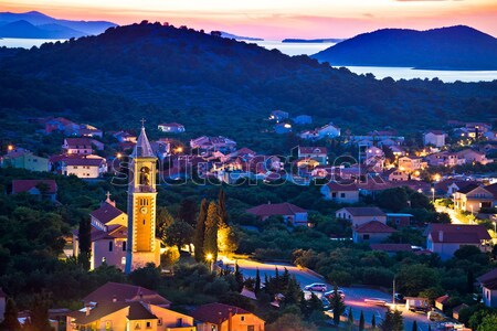 Colorido madrugada ilha costa montanha ver Foto stock © xbrchx