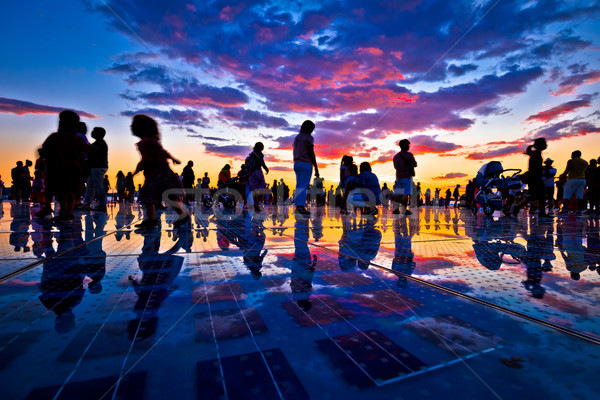 Mensen silhouet kleurrijk zonsondergang stad zon Stockfoto © xbrchx