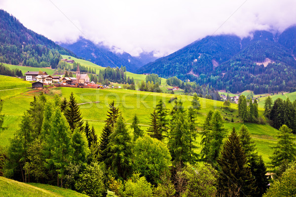 Saint Magdalena alpine village in Val Funes Stock photo © xbrchx