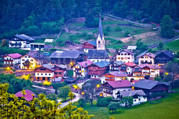 Picturesque alpine village of Tisens aerial evening view Stock photo © xbrchx