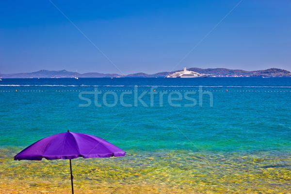 Adriatic beach in Zadar with megayacht background Stock photo © xbrchx