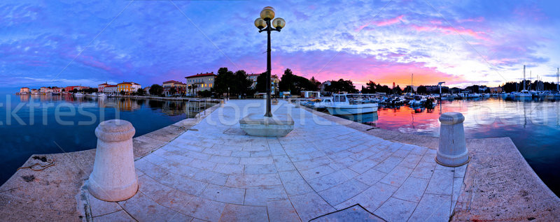 Town of Porec morning sunrise panoramic view from pier Stock photo © xbrchx
