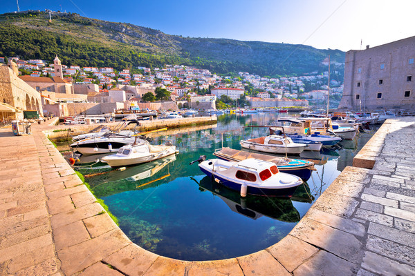 Dubrovnik harbor and city walls morning view Stock photo © xbrchx