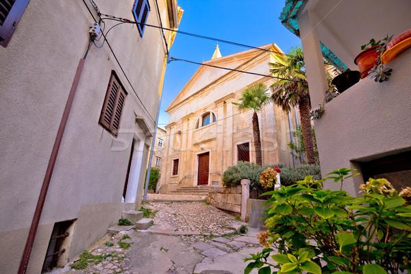 Old adriatic town Vrbnik stone street and church view Stock photo © xbrchx