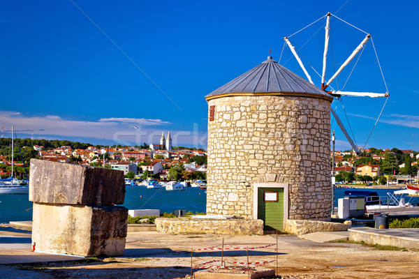 Town of Medulin windmill landmark and waterfront view Stock photo © xbrchx