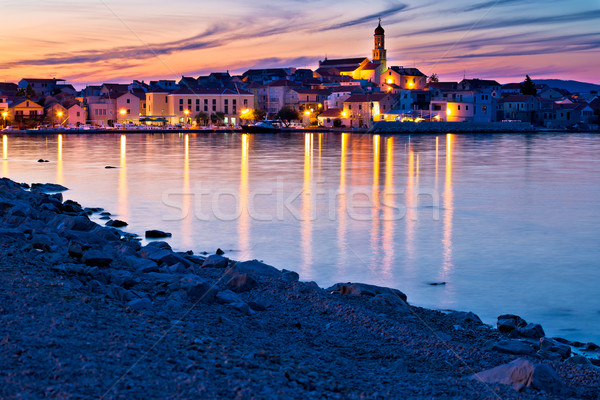 Stad strand zonsondergang eiland water Stockfoto © xbrchx