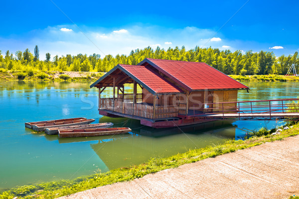 Drava river floating wooden cabin Stock photo © xbrchx