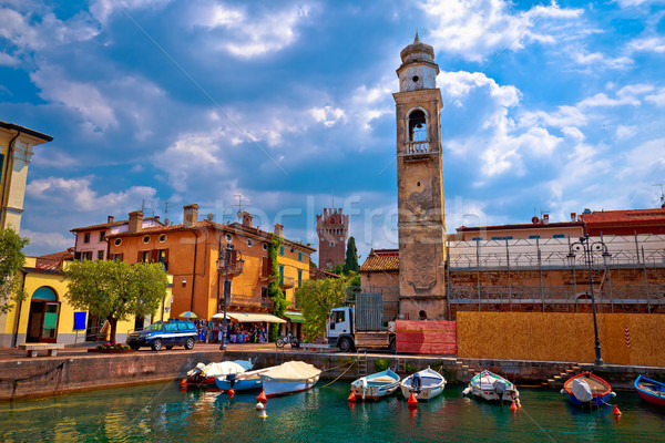 Lazise colorful harbor and boats view Stock photo © xbrchx