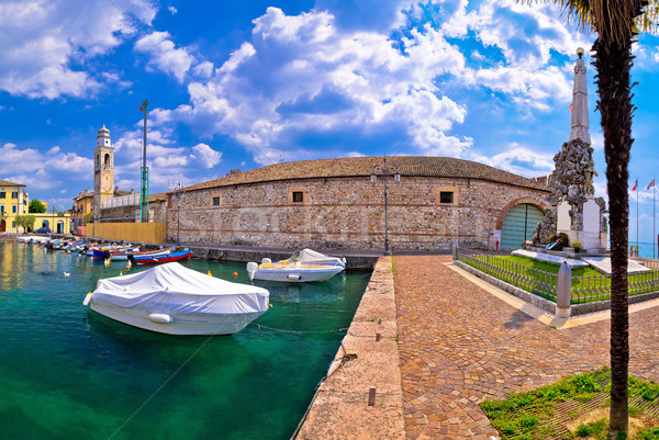 Lazise colorful harbor and boats panoramic view Stock photo © xbrchx