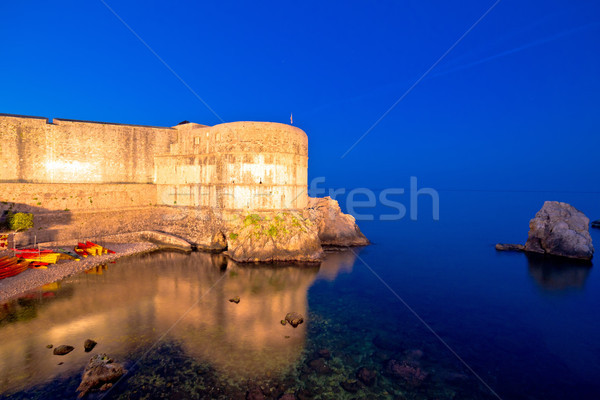 Dubrovnik walls and waterfront evening view Stock photo © xbrchx