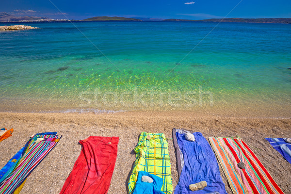 Towels on idyllic beach in Kastela bay Stock photo © xbrchx