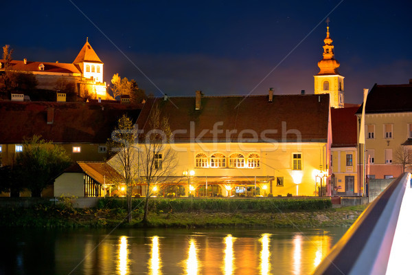 Old Town of Ptuj evening riverfront view Stock photo © xbrchx