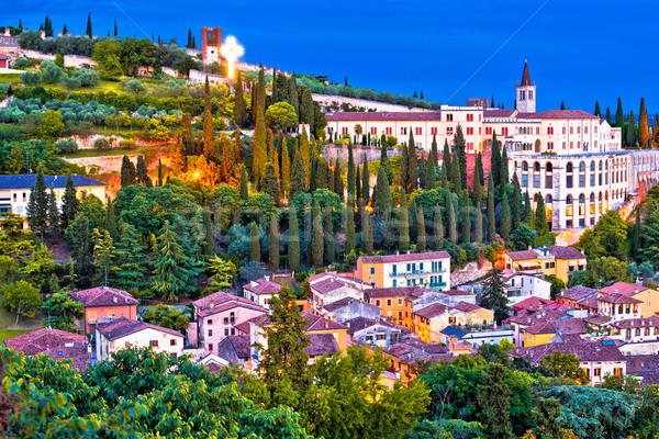 Verona city walls and Opera Don Calabria evening view Stock photo © xbrchx