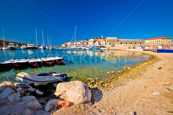 Primosten turquoise beach and harbor view Stock photo © xbrchx