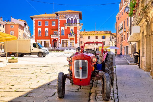 Town of Vodnjan colorful square and old tractor view Stock photo © xbrchx