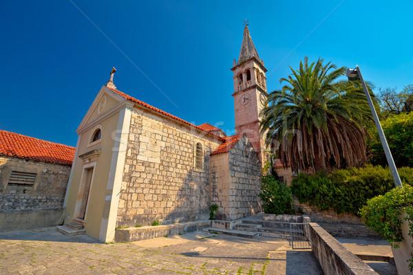 Pierre village église vue sur la rue île ciel Photo stock © xbrchx