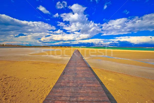 Wooden boardwalk and sand beach of Nin Stock photo © xbrchx