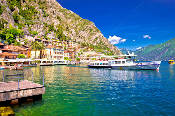 Tourist boat in Limone sul Garda picturesque harbor Stock photo © xbrchx