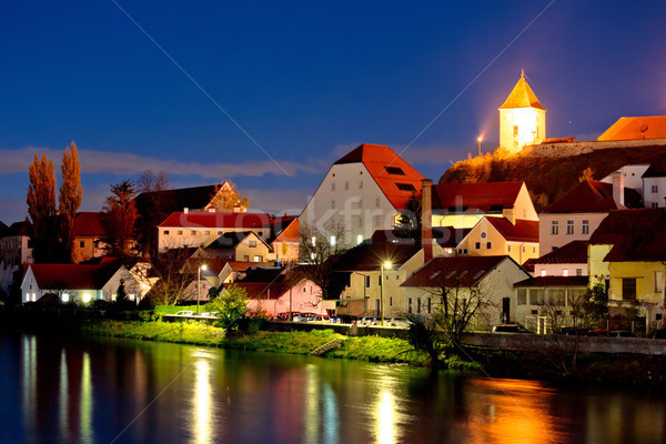 Town of Ptuj and Drava river evening riverfront view Stock photo © xbrchx