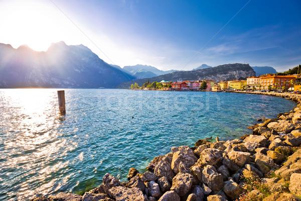 Lago di Garda town of Torbole sunset view Stock photo © xbrchx