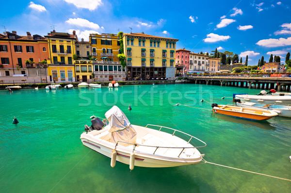 Peschiera del Garda colorful harbor and boats view Stock photo © xbrchx