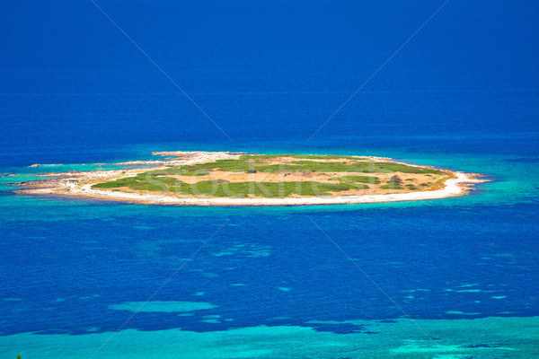 Island in turquoise sea aerial view Stock photo © xbrchx