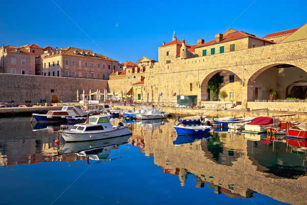 Dubrovnik harbor and city walls morning view with calm sea Stock photo © xbrchx