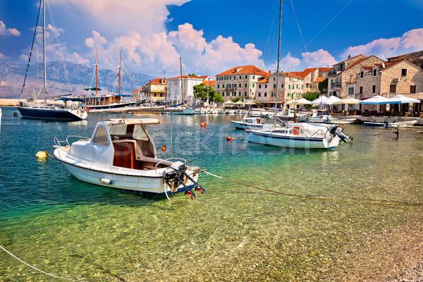 Turquoise beach and harbor of Postira village Stock photo © xbrchx