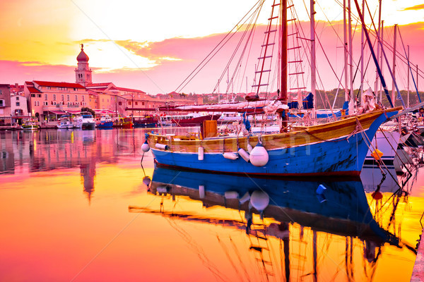 Historic island town of Krk golden dawn waterfront view Stock photo © xbrchx