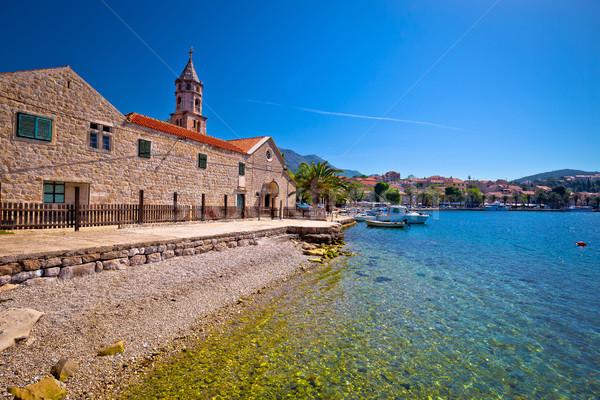 Plage bord de l'eau église vue région Croatie Photo stock © xbrchx