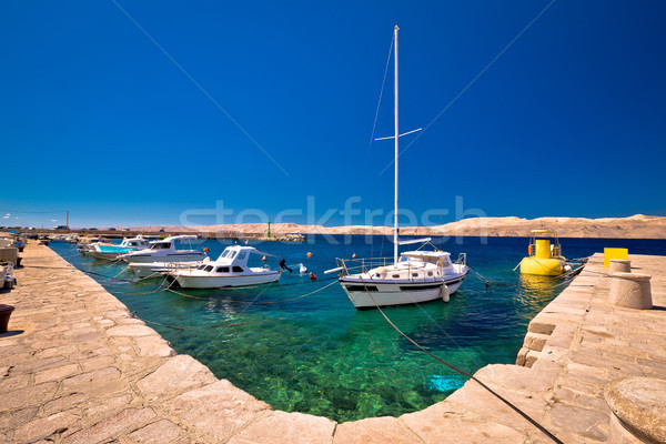 Floating boat on turquoise sea in Velebit channel Stock photo © xbrchx