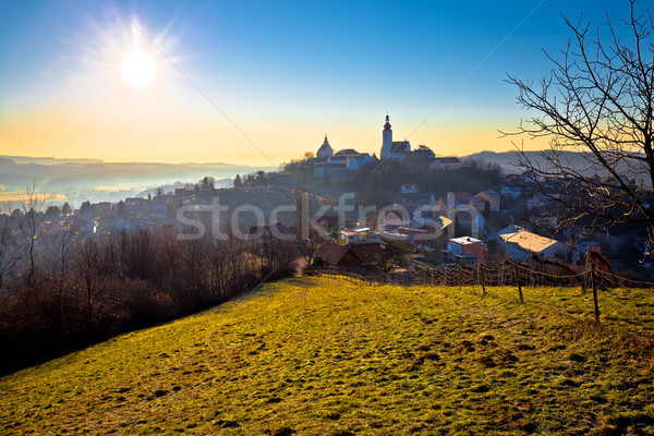 Stock photo: Straden village in fog church on the hill