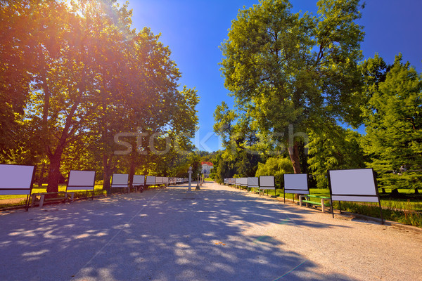 Tivoli park and in Ljubljana walkway in red sun haze view Stock photo © xbrchx